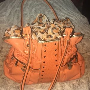 Pumpkin orange colored purse
